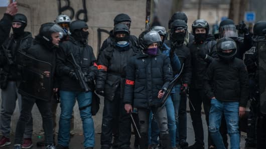 Plain clothes police officers with riot shields, batons and rubber bullet guns police the Yellow Vest movement protests for the tenth week running on January 19, 2019 in Paris, France.