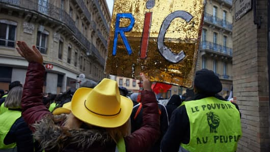 A Yellow Vest protester holds a placard calling for the RIC (Citizens Initiated Referendum). For the Act XI  of the Yellow Vest movement, more than 10 000 people took to the streets of Toulouse for the anti-governement protest on January 26th 2019.