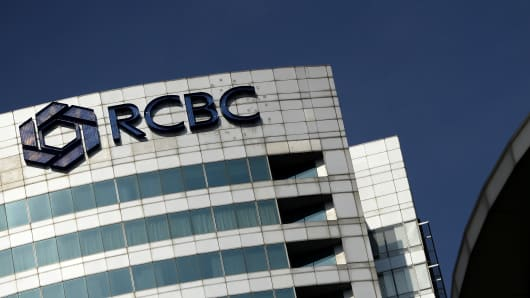 The logo of the RCBC bank is seen at the RCBC building in Manila's financial district on March 11, 2016.