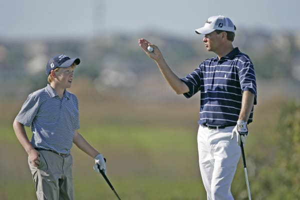 Davis and Dru Love compete in the final round of the MBNA Father/Son Challenge at ChampionsGate golf course, ChampionsGate, FL Sunday, December 4, 2005