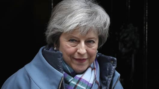 Britain's Prime Minister Theresa May leaves from 10 Downing Street in London on January 29, 2019, to head to the House of Commons.
