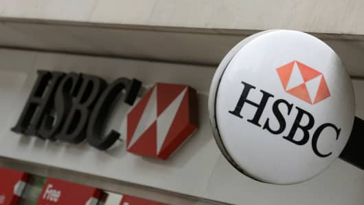 A logo sits outside a HSBC bank branch in London.