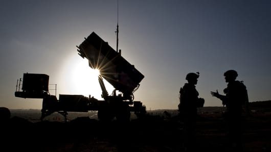 U.S. Soldiers talk after a routine inspection of a Patriot missile battery at a Turkish military base in Gaziantep, Turkey.