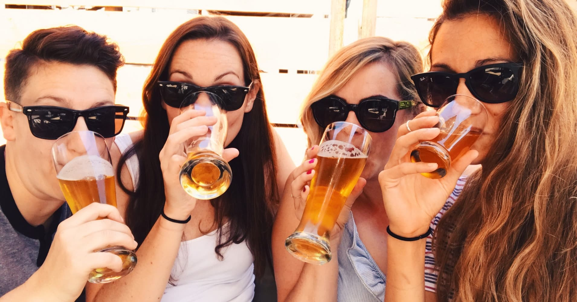 Young people drinking beer.