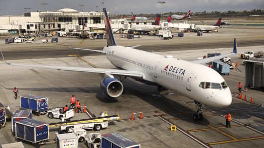 A Delta flight arrives at LAX Terminal 2.