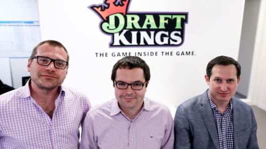 From left, the three co-founders of DraftKings, Matt Kalish, Paul Liberman and Jason Robins, pose together in their Boston office on Apr. 24, 2017.
