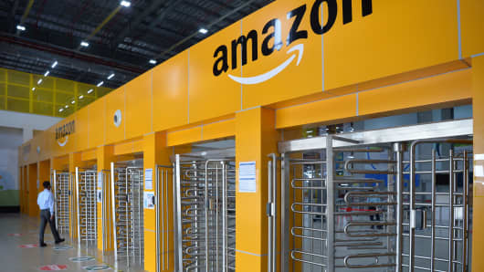 An employee of Amazon India walks toward a security gate at the company's newly launched fulfillment center on the outskirts of Bangalore.