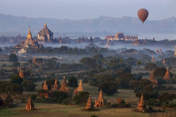 Early morning aerial view of the temples of the Archaeological Zone near the Irrawaddy River in Bagan in Myanmar (Burma).