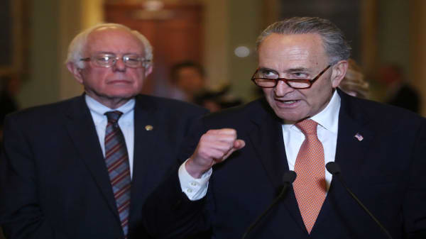 Chuck Schumer, Bernie Sanders call for limits on corporate buybacks