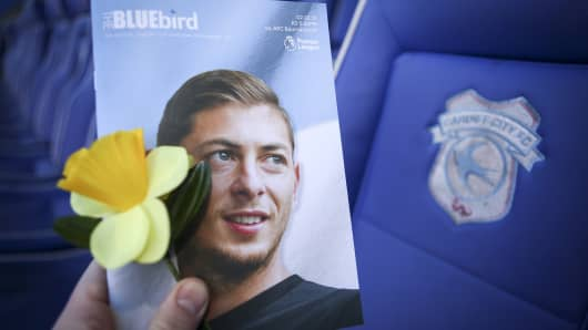 The Match Day Programme with a Daffodil as a tribute to Emiliano Sala during the Premier League match between Cardiff City and AFC Bournemouth at Cardiff City Stadium on February 2, 2019.