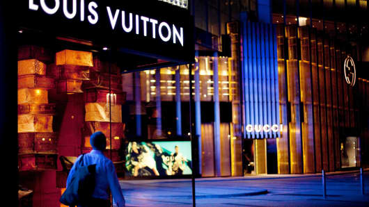 A man passes a Louis Vuitton store in Macau, China, on Friday, Dec. 10, 2010.