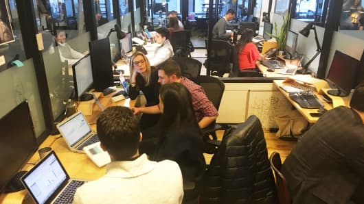 Employees of EasyKnock working in their office.