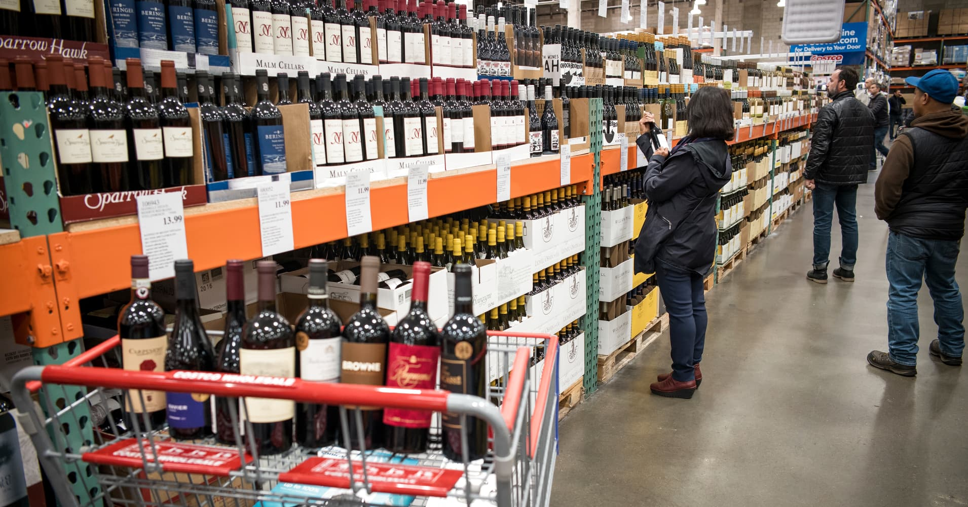 Customers browse wine for sale at a Costco  store in San Francisco in December 2018.