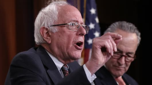 U.S. Sen. Bernie Sanders (L) (I-VT) answers questions with Senate Minority Leader Chuck Schumer (R) (D-NY) during a press conference at the U.S. Capitol in Washington, DC.