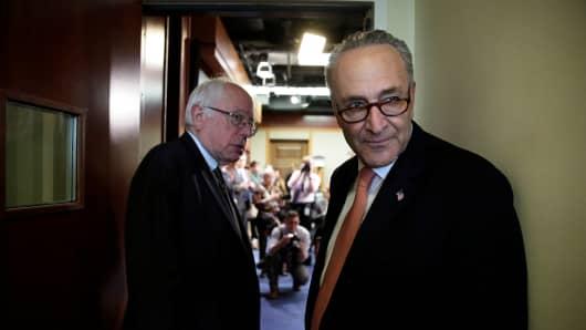 Senate Minority Leader Chuck Schumer (D-NY) (R) and Sen. Bernie Sanders (D-VT).