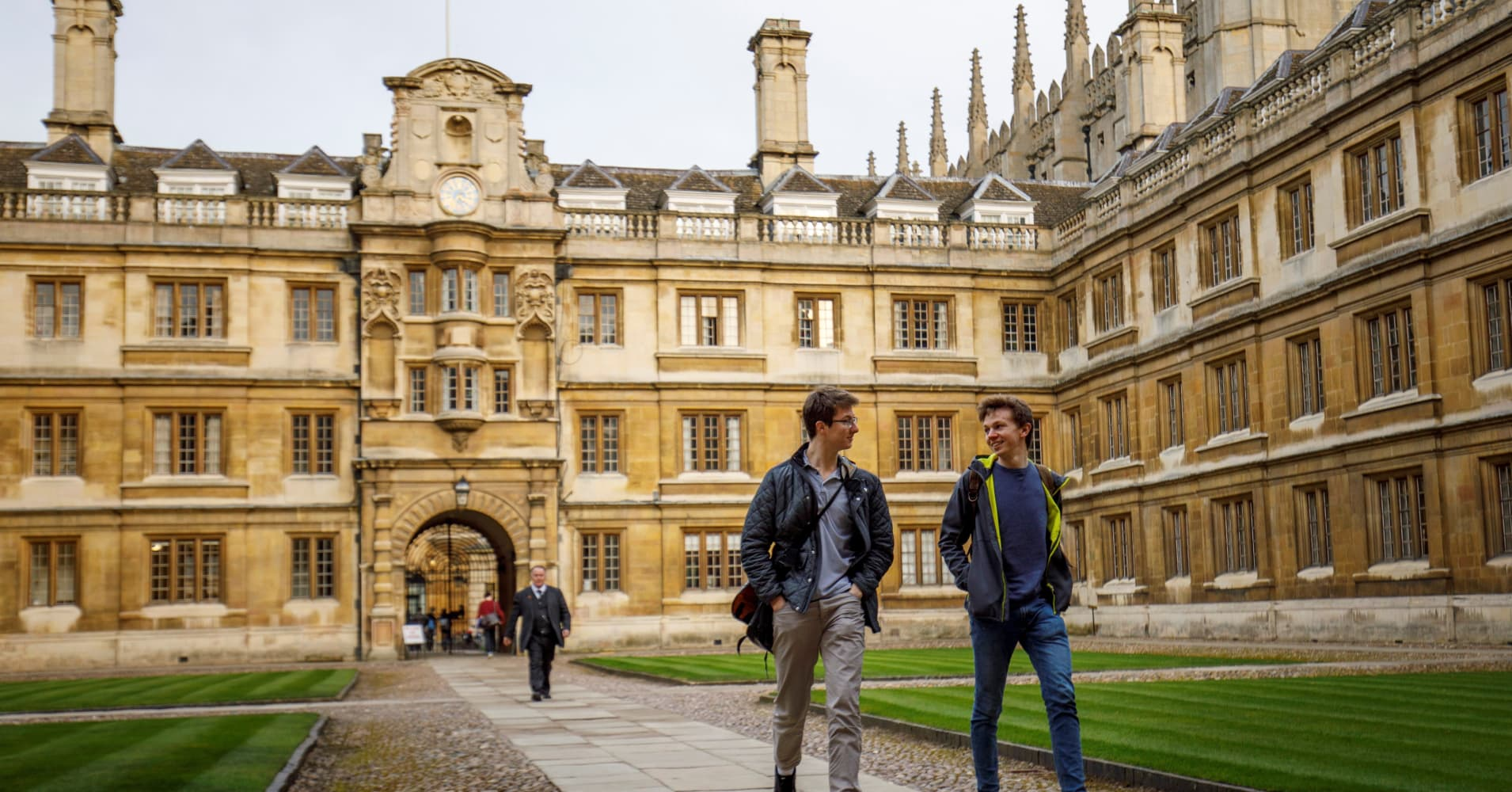 Students walk through Cambridge University in Cambridge, east of England, on March 14, 2018.