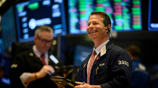 A trader laughs ahead of the closing bell on the floor of the New York Stock Exchange (NYSE) on February 1, 2019 in New York City.
