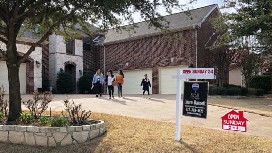 Prospective buyers at an open house  outside Dallas in Coppell, Texas.