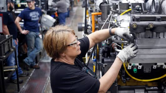 A worker assembles components on a diesel engine at the Cummins Inc. Seymour Engine Plant in Seymour, Indiana, on Tuesday, Jan. 29, 2019.