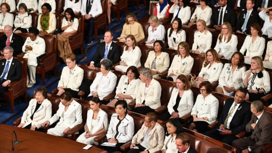 Lawmakers attend US President Donald Trump's State of the Union address at the US Capitol in Washington, DC, on February 5, 2019. - Women from both political parties wore white outfits tonight at the behest of the Democratic Womens Working Group to honor the legacy of women's suffrage in the United States.