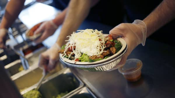 An employee prepares a burrito bowl at a Chipotle Mexican Grill Inc. restaurant in Louisville, Kentucky, Feb. 2, 2019.