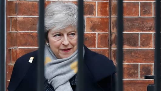 Britain's Prime Minister Theresa May leaves 10 Downing Street in London on February 5, 2019. - A top EU official warned Monday that the prospect of Britain crashing out of the bloc next month looks more likely than ever, as Prime Minister Theresa May sought to reassure foreign investors worried about a chaotic Brexit.