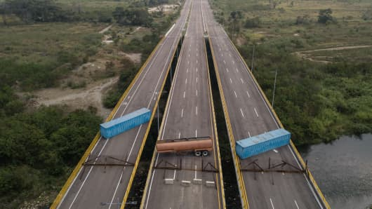 A gas tank and shipping containers obstructing passage to Venezeula are seen on the Tienditas International Bridge in an aerial photograph taken over Cucuta, Colombia, on Wednesday, Feb. 6, 2019.