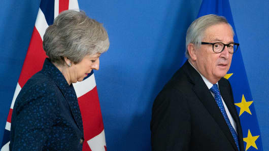 Theresa May, U.K. prime minister, left, and Jean-Claude Juncker, president of the European Commission, arrive ahead of talks in Brussels, Belgium, on Thursday, Feb. 7, 2019.