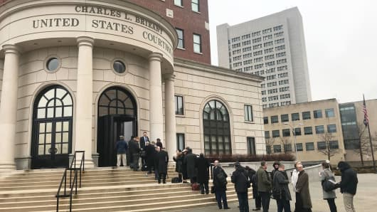 People line up outside the U.S. Courthouse in White Plains, New York, Feb. 7, 2019.