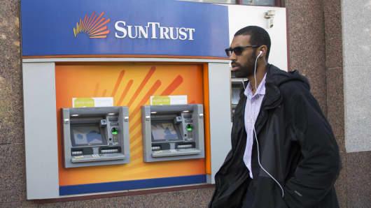 A man walks past a SunTrust bank in Washington, DC.