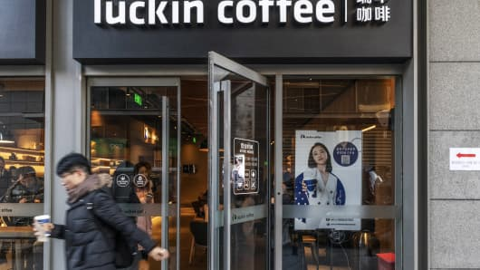 A customer exits a Luckin Coffee outlet in Beijing, China, on Tuesday, Jan. 15, 2019.