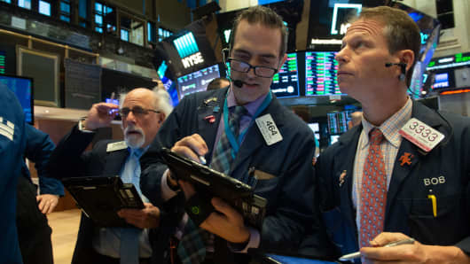 Traders work on the floor at the closing bell of the Dow Industrial Average at the New York Stock Exchange on January 10, 2019 in New York.