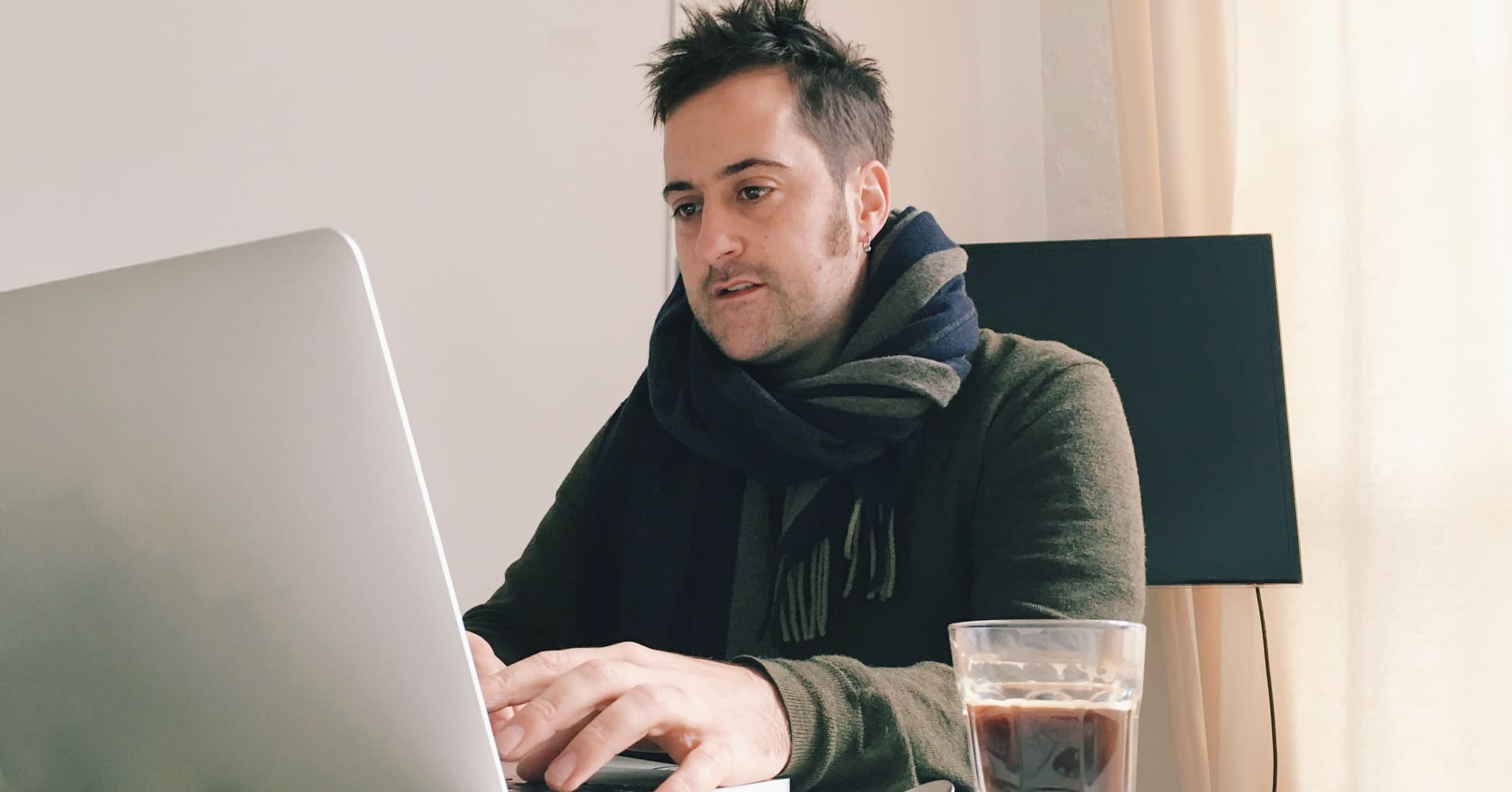Man uses laptop to file his income taxes.