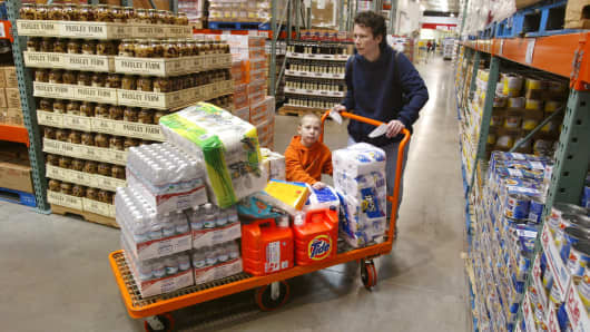Chicago resident and her son shop at Costco with a large grocery cart.