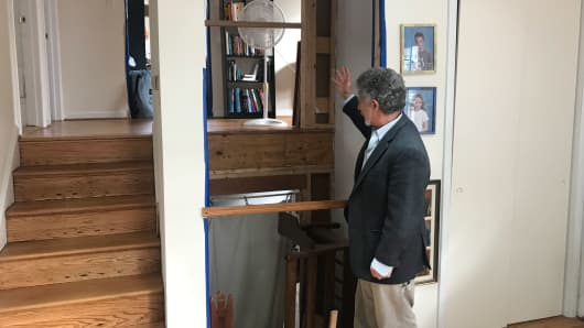 Louis Tenenbaum, a Housing Advocate, showing us the elevator shaft that he retrofitted into his home.