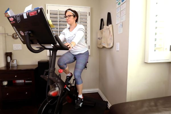 Sara Richards rides her Peloton at home.