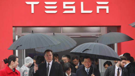 Tesla boss Elon Musk (L) walks with Shanghai Mayor Ying Yong during the ground-breaking ceremony for a Tesla factory in Shanghai on January 7, 2019. - Musk presided over the ground-breaking for a Shanghai factory that will allow the electric-car manufacturer to dodge the China-US tariff crossfire and sell directly to the world's biggest market for'green' vehicles. (Photo by STR / AFP) / China OUT (Photo credit should read STR/AFP/Getty Images)