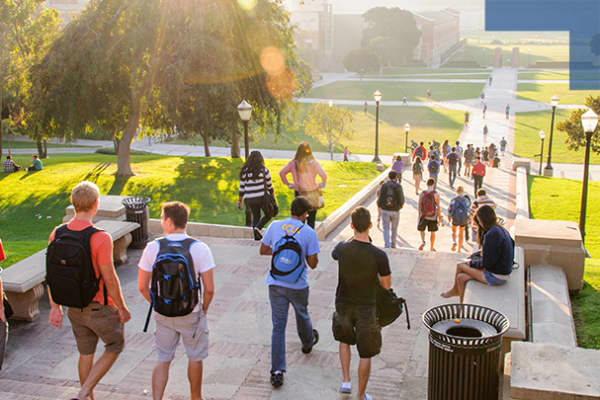 Students walking on college campus.