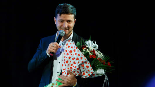 Ukrainian entertainer and presidential candidate Volodymyr Zelensky holds a bunch of flowers after performing on stage  in western Ukrainian city of Uzhhorod, on February 9, 2019.