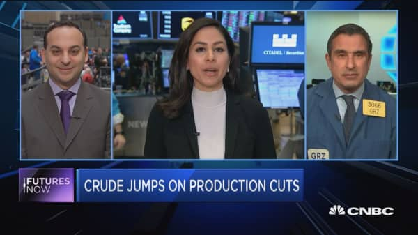 Crude oil jumps on production cuts