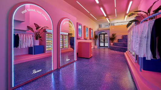 Pink neon lights brighten up the inside of Recess' new store.