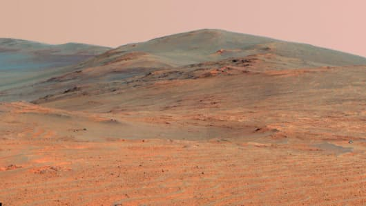 "This vista of the Endeavour Crater rim was acquired by NASA's Mars Exploration Rover Opportunity from the southern end of ""Murray Ridge"" on the western rim of the crater."