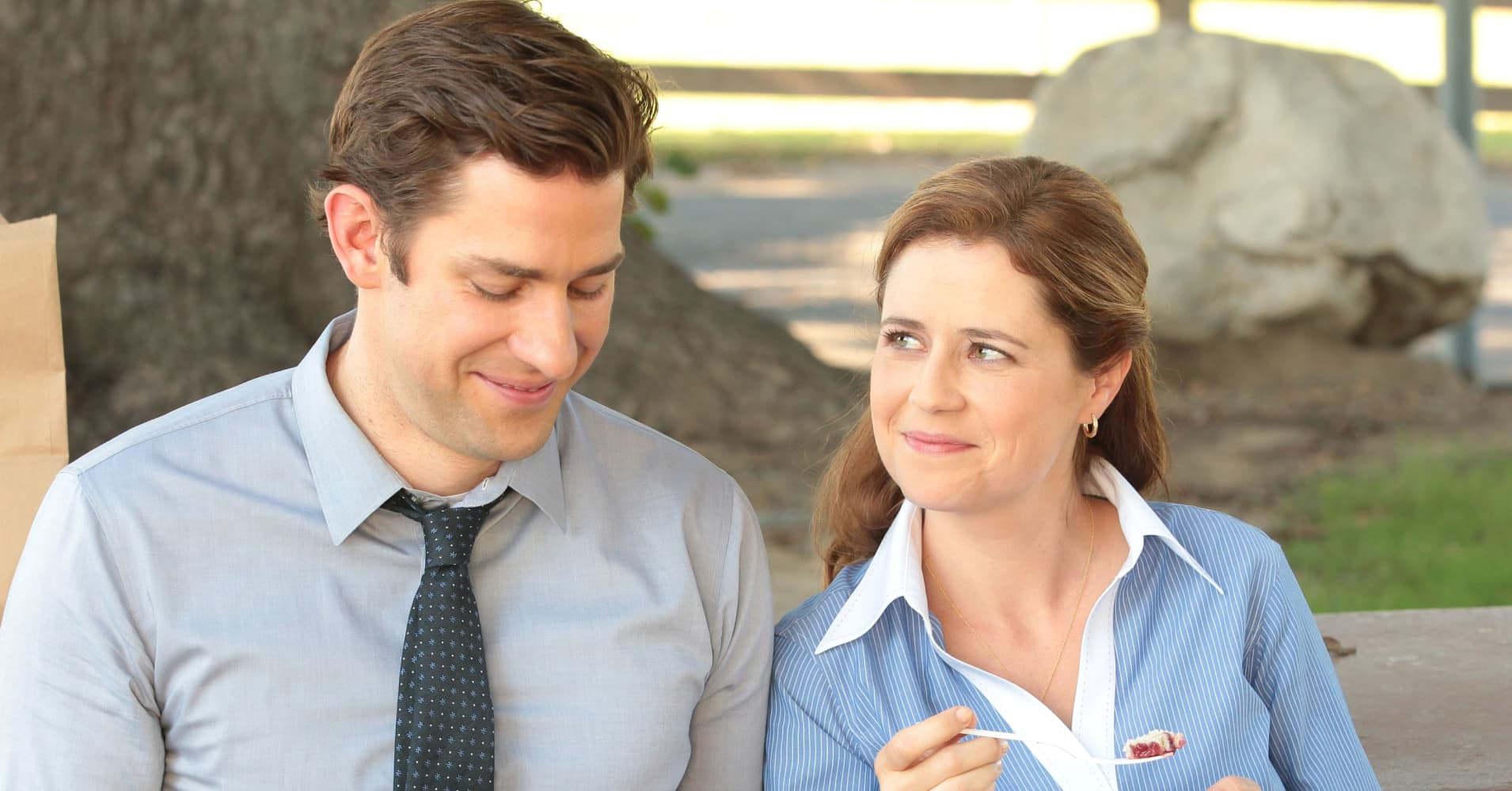 John Krasinski and Jenna Fischer play Jim Halpert and Pam Halpert in the TV show The Office. Their characters are well-known for being coworkers whose crushes turn into marriage.
