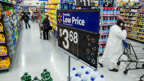 Customers shop at a Walmart store in Secaucus, New Jersey, on Wednesday, May 16, 2018.
