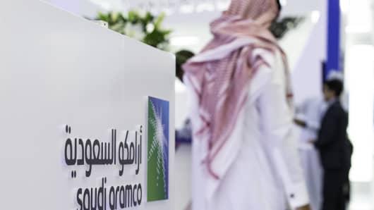 A Saudi Aramco logo sits on display during the Abu Dhabi International Petroleum Exhibition & Conference in Abu Dhabi, United Arab Emirates, on Nov. 13, 2018.