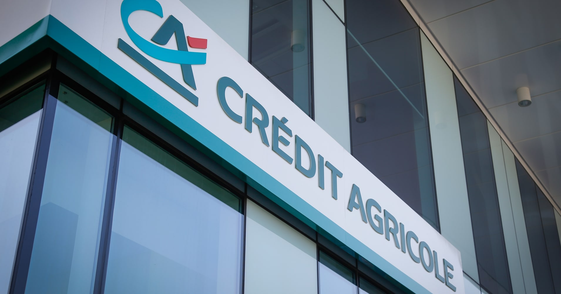Credit Agricole's fourth-quarter profits rise more than expected, meets targets a year early