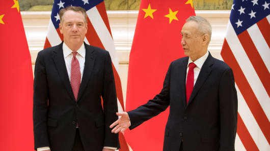 Chinese Vice Premier and lead trade negotiator Liu He, right, reaches to shake hands with U.S. Trade Representative Robert Lighthizer before the opening session of trade negotiations at the Diaoyutai State Guesthouse in Beijing, Thursday, Feb. 14, 2019.