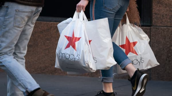 Shoppers walk outside the Macy's store in New York's Herald Square January 11, 2019.