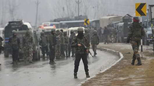 February 14, 2019: Indian security forces at the site of the explosion on the Jammu-Srinagar highway.