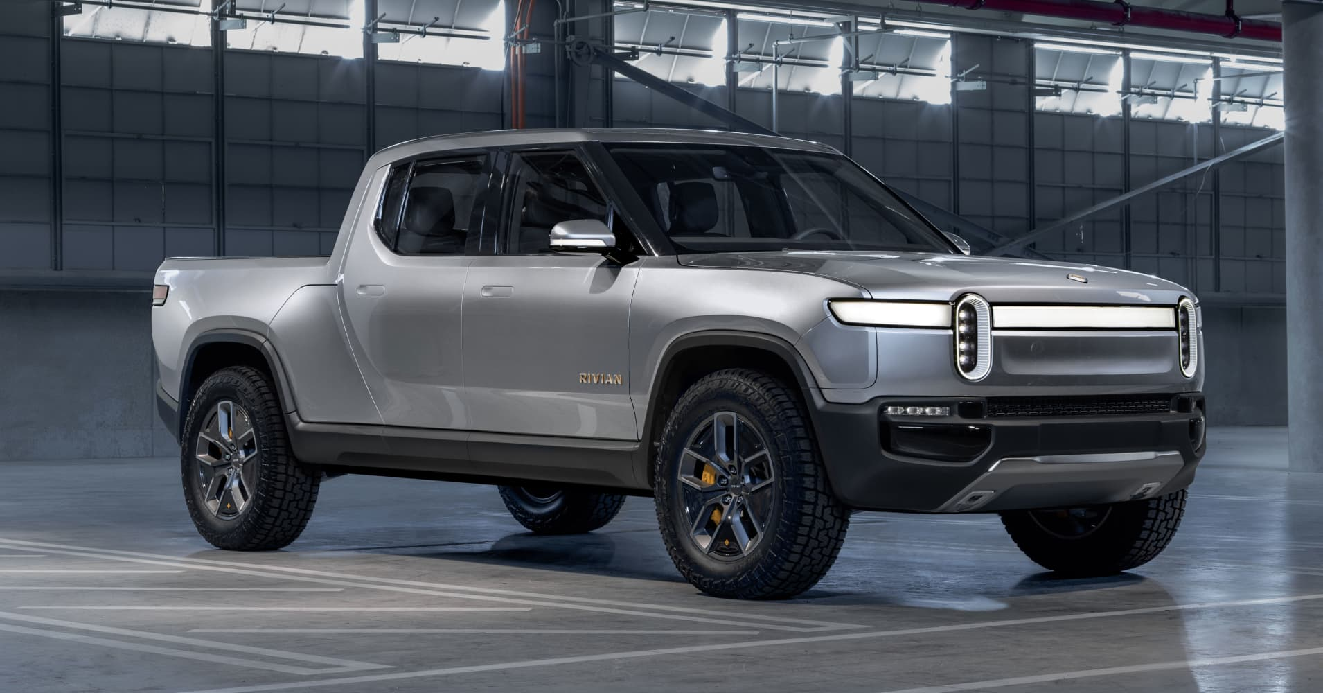 Rivian announces $700 million investment round led by Amazon